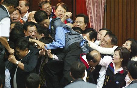 Taiwan legislators fight due to a disagreement over a bill in parliament in Taipei May 8, 2007. REUTERS/Stringer