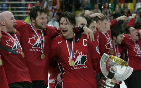 Players of the Canadian team celebrate during the medal ceremony after winning the Ice Hockey World Championship final against Finland in Moscow May 13, 2007. Canada won the match 4-2. REUTERS/Sergei Karpukhin