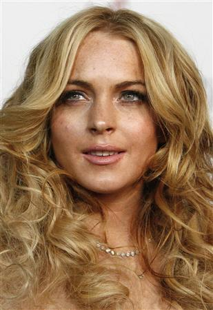 Actress Lindsay Lohan arrives at a party in Los Angeles, California in this April 26, 2007 file photo. Lohan has topped Maxim magazine's list of the 100 hottest women in the world -- while her celebrity late-night party friends Britney Spears and Paris Hilton failed to make the cut on May 15, 2007. REUTERS/Mario Anzuoni/Files