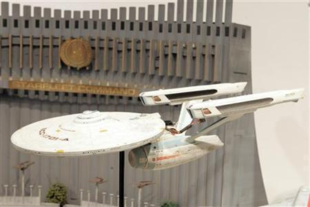 A replica of the Starship Enterprise sits on display with other props from the television series ''Star Trek'' during a press preview of the auction ''40 Years of Star Trek: The Collection'' at Christie's auction house in New York September 29, 2006. Lottery chiefs have turned down bizarre bids for grants to pay for everything from a replica of the Starship Enterprise to double-glazing in a private house. REUTERS/Keith Bedford