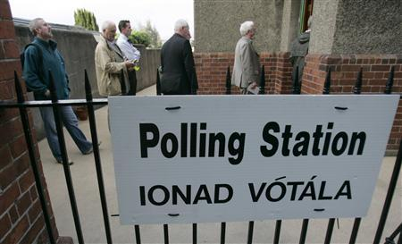 Voters wait for a polling station to open in Dublin, May 24, 2007. REUTERS/Luke MacGregor