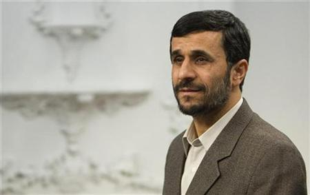 Iran's President Mahmoud Ahmadinejad (R) waits during meeting with the Director General of the Islamic Educational, Scientific and Cultural Organization (ISESCO) Abdul Aziz Bin Osman Al-Tajviri in Tehran May 20, 2007. Iran is close to achieving its ''ultimate goals'', Ahmadinejad said on Thursday, accusing the West of trying to stop Tehran's nuclear programme in order to reduce its influence in the world. REUTERS/Raheb Homavandi