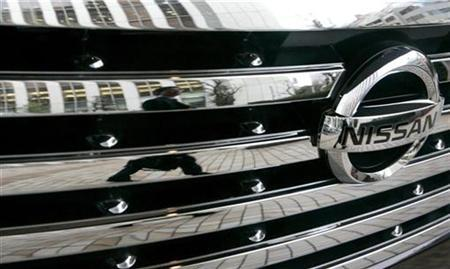 A man is reflected on a car from Nissan Motor Co. at the company headquarters in Tokyo April 26, 2007. Nissan North America has a warning for customers: placing your electronic key too close to your cellphone could leave you stranded. REUTERS/Toru Hanai