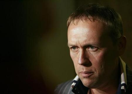 In this file picture, former Kremlin bodyguard Andrei Lugovoy listens to a question during an interview at Moscow's Ekho Moskvy (Moscow Echo) radio station, February 23, 2007. Britain on Monday made an official request to Russia to extradite Lugovoy, who is suspected of killing ex-KGB agent Alexander Litvinenko with radioactive polonium-210. REUTERS/Denis Sinyakov