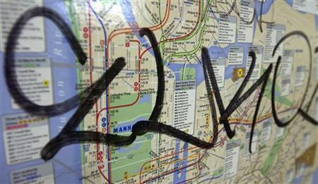 Damage to a subway map waits to be cleaned in this April 18, 2003 file photo. Global positioning systems (GPS), digital photography and computer databases are joining the humble paint can as U.S. cities battle to obliterate graffiti and catch its shadowy perpetrators. REUTERS/Chip East
