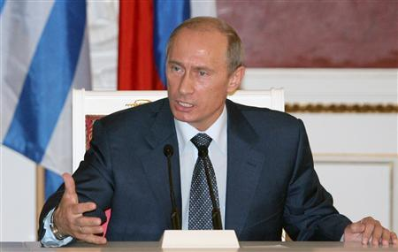 Russian President Vladimir Putin gestures during a news conference after his meeting with Greek counterpart Carolos Papoulias in Moscow May 31, 2007. REUTERS/Alexander Nemenov/Pool