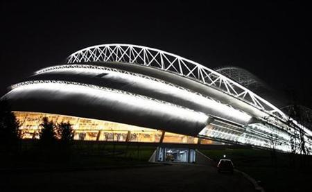 A night view of the Shenyang Olympic Sports Centre Stadium, one of the five football venues of the 2008 Beijing Olympic Games, in Shenyang, capital of northeast China's Liaoning province May 21, 2007. Some 1.5 million residents of Beijing will be displaced by the time the city hosts the 2008 Olympics, many of them evicted from their homes against their will, a housing rights group said on Tuesday. REUTERS/Stringer