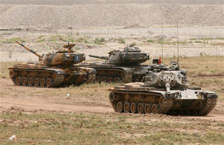Turkish tanks take part in a military exercise near the southeast Turkish town of Cizre, some 50 km (30 miles) from Turkey's Habur border gate to Iraq, June 7, 2007. REUTERS/Osman Orsal