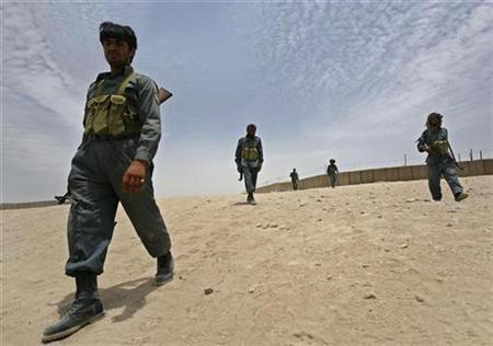 Afghan police patrol in the Sangin valley in the southern province of Helmand June 8, 2007. REUTERS/Ahmad Masood