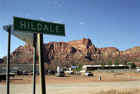 A sign marks the town of Hildale, Utah, home to the nation's largest polygamist community -- the Fundamentalist Church of Jesus Christ of Latter Day Saints (FLDS), a polygamist sect that broke from the mainstream Mormon church 72 years ago, in this photo taken May 31, 2007. REUTERS/Jason Szep