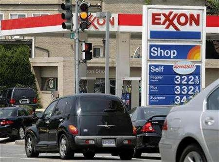 A sign displays prices at a gas station in Washington July 27, 2006. Exxon Mobil Corp. never in the past decade doubted the risk from climate change, its global spokesman Kenneth Cohen said on Thursday, in a latest attempt to improve its green credentials. REUTERS/Yuri Gripas