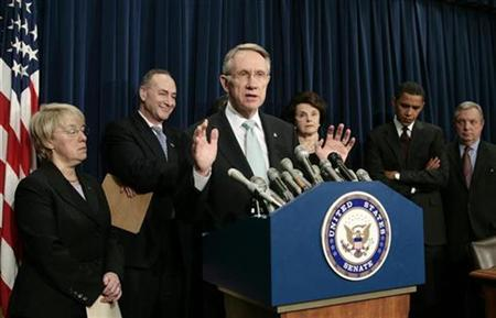 Senate majority leader Harry Reid (C) speaks during a news conference along with other Democratic Senators in the Capitol in Washington January 18, 2007. The new Democratic-led Congress is drawing the ire of voters upset with its failure to quickly deliver on a promise to end the Iraq war. REUTERS/Kevin Lamarque