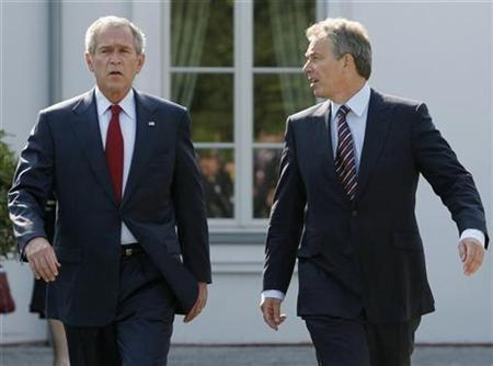A file photo of British Prime Minister Tony Blair (R) walking with President George W. Bush at the G8 summit in Heiligendamm, June 7, 2007. Bush wrote a lengthy tribute to Blair on his last day in power on Wednesday, describing him as ''a strong guy'' and dismissing claims that the British leader acted as his ''poodle.'' REUTERS/Jim Young