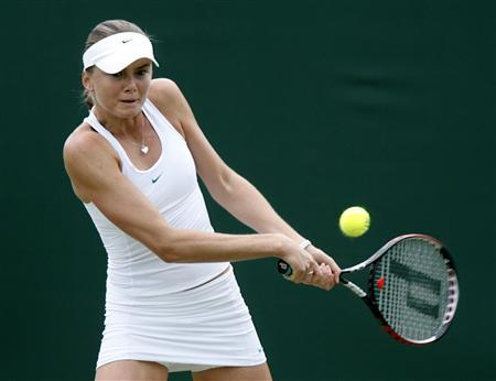 Slovakia's Daniela Hantuchova plays a return to Russia's Elena Likhovtseva during their singles match at the Wimbledon tennis championships in London, June 28, 2007. REUTERS/Alessia Pierdomenico