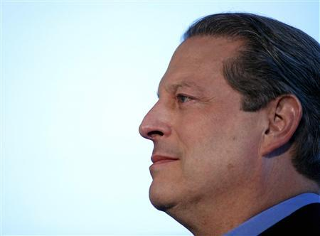 Al Gore listens to a speaker at a news conference to introduce a call to action on climate control in conjunction with the Live Earth concert in New York, June 28, 2007. The Live Earth concert will feature hundreds of musical acts and take place on July 7, 2007 on seven continents simultaneously. Gore slammed the United States and some other big polluters for forming what he called a sham global warming pact separate from the rest of the world. REUTERS/Jeff Zelevansky