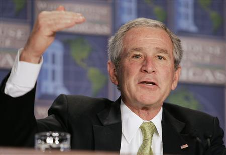 U.S. President George W. Bush speaks while participating in a discussion panel at the White House Conference on the Americas, in Arlington, Virginia July 9, 2007. Bush has no plans to withdraw troops from Iraq now, the White House said on Monday, despite increasing pressure from members of his own Republican party for a change in war strategy. REUTERS/Larry Downing