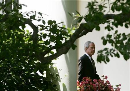 President George W. Bush walks to the Oval Office at the White House in Washington July 3, 2007. The White House on Monday dared the Democratic-led Congress to fight it in court by refusing to provide information and testimony demanded in an investigation into the firing of federal prosecutors. REUTERS/Jim Young
