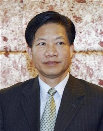 Zheng Xiaoyu, former director of China's State Food and Drug Administration (SFDA), is seen during a meeting in Beijing in this October 28, 2004 file photo. China on Wednesday hailed the swift execution of the nation's former drug safety chief as a warning to corrupt officials while detailing a web of graft that thrived for years without punishment. REUTERS/China Daily/Files