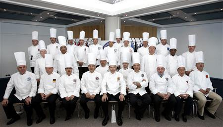 Members of the Heads of State Chefs club pose for a group photo in Monte Carlo July 12, 2007. The association of chefs, who are privileged to prepare their culinary creations in the palaces of Kings and Queens and presidential residences, gather each year in a different country. REUTERS/Pascal Deschamps