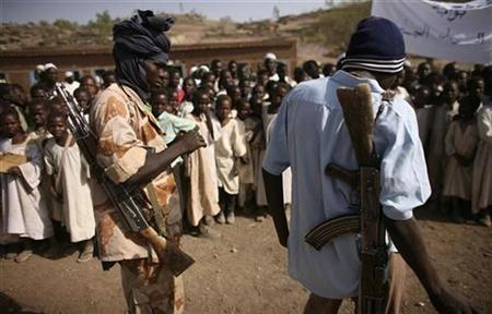Rebel soldiers with the Sudanese Liberation Army (SLA) keep guard at a camp for displaced people near El-Fasher, capital of the north Darfur region, March 25, 2007. Five Darfur rebel groups agreed on Saturday to unite ahead of possible peace talks to end a four-year conflict in the region which so far has defied resolution, in part because of fractious rebel groups. REUTERS/Michael Kamber