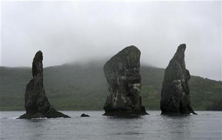 Rock towers stand in the sea off the coast of Russia's far eastern Kamchatka peninsular June 17, 2007. Gold miners on Russia's Kamchatka peninsular contend with volcanic eruptions , floods and poor infrastructure, but due to high metal prices the hard work pays off. REUTERS/Olesya Dmitracova