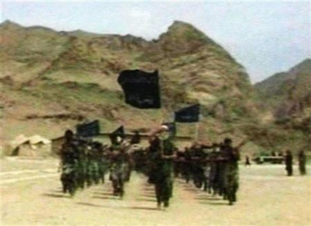 Recruits of Osama bin Laden are seen marching in this frame grab from an undated training video at an undisclosed location in Afghanistan. U.S. intelligence agencies on Tuesday warned that al Qaeda would intensify efforts to put operatives inside the United States and said there was a heightened threat of attack. REUTERS/Stringer