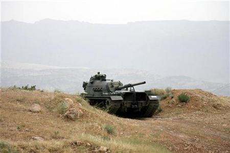 A Turkish tank is seen on a hillside overlooking the mountainous Iraqi border on the outskirts of Sirnak in southeast Turkey, some 50 km (30 miles) from the Iraqi border, June 8, 2007. Turkey's army heavily shelled Kurdish rebel targets just inside the border of northern Iraq on Wednesday, a Kurdish official said on Thursday, adding there were no casualties. REUTERS/Osman Orsal