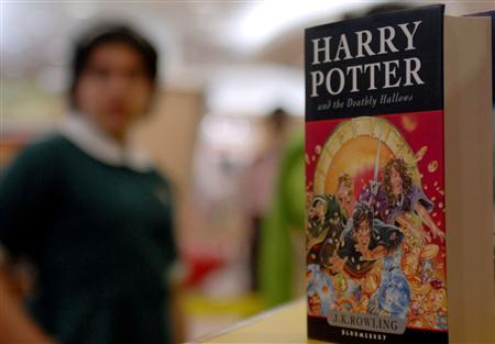 A copy of the new ''Harry Potter and the Deathly Hallows'' by J.K. Rowling is seen at a counter as fans queue up during its release at a bookstore in the southern Indian city of Hyderabad July 21, 2007. REUTERS/Krishnendu Halder