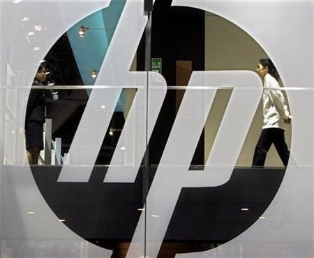 An employee walks past a Hewlett-Packard logo during the second day of the International Telecommunication Union (ITU) Telecom World 2006 in Hong Kong in this December 5, 2006 file photo. Hewlett-Packard Co. said on Monday it will buy software companies Opsware Inc. for $1.6 billion and Neoware Inc. for $214 million to bolster its business of helping corporate customers manage computer systems. REUTERS/Paul Yeungvv