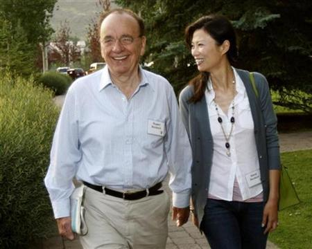News Corp. chief Rupert Murdoch and his wife Wendi Deng arrive for the second session of the Allen and Co. conference at the Sun Valley Resort in Sun Valley, Idaho July 12, 2007. The 76-year-old media mogul aims to redeem his legacy in the business he loves most with the anticipated $5 billion purchase of Dow Jones, owner of The Wall Street Journal, Barron's financial weekly and Dow Jones Newswires. REUTERS/Rick Wilking
