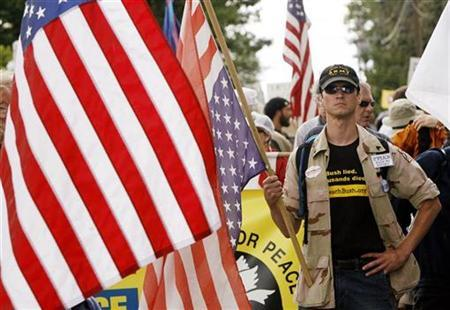 Afghanistan U.S. Army veteran Ted Goodright of Rhode Island leads the way with the ''Veterans for Peace'' group during an anti-war protest in the streets of Kennebunkport, Maine, July 1, 2007. Political analysts say there is a groundswell among Americans of every political stripe who are calling for change in government. REUTERS/Jim Bourg