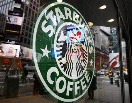 The Starbucks logo is seen outside a coffee-shop in New York's Times Square March 15, 2007. Starbucks sees ample room for growth in selling Starbucks-branded products such as coffee beans, ice cream and chocolate in supermarkets and convenience stores, a company executive said on Monday.REUTERS/Shannon Stapleton