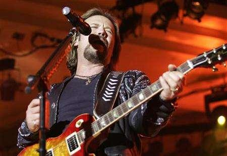 Country music singer Travis Tritt performs at the Silver Star Casino in Choctaw, Mississippi November 10, 2005. Randy Jackson's claim that it qualifies as ''blue-eyed soul'' is a stretch (not enough falsettos), but Travis Tritt's new album ''The Storm'' certainly has some funk-flirting moments: most blatantly, the Richard Marx cover ''You Never Take Me Dancing'' and audacious beefcake bump-and-grind ''Rub Off on Me,'' borderline porn for housewives with barely embellished R&B backup singers stretching out the climax. EUTERS/Kyle Carter