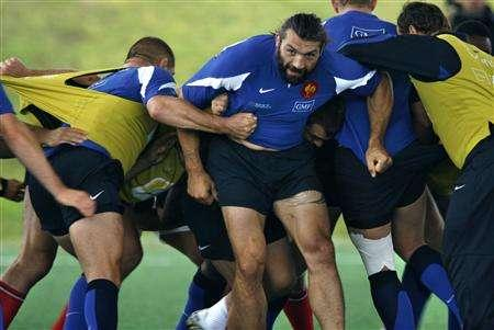 Sebastien Chabal (C) of the French national rugby union squad takes part in a training session at the Rugby Union National Centre in Marcoussis, south of Paris, August 23, 2007. The Rugby World Cup, the most popular global sporting event of the year, kicks off in two weeks. Most Americans and many others in other big TV markets like Germany are not even aware of the tournament. But global viewership is expected to reach new heights -- we're talking 4 billion -- given that the sport has rapidly gained a passionate following outside its traditional hotbeds of the U.K. and the Southern Hemisphere. REUTERS/Charles Platiau