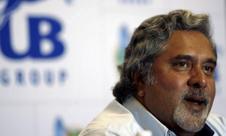 United Breweries Group Chairman Vijay Mallya speaks during a news conference in Mumbai September 1, 2007. Spyker's director of Formula One, Michiel Mol, has teamed up with Mallya to make an 80 million euro ($109.3 million) bid for the cash-strapped team. REUTERS/Punit Paranjpe