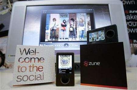 Microsoft's Zune media player is shown for the first time to the media in Redmond, Washington September 14, 2006. Microsoft Corp cut the price of its Zune digital music player on Wednesday by $50 to $199 in an attempt to rev up sales of the device competing against Apple Inc's iPod. REUTERS/Robert Sorbo