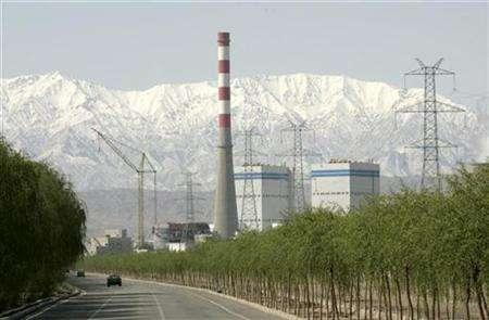 A thermal power station is seen in front of the snow-covered Qilian Mountains in Jiayuguan, northwest China's Gansu province, April 28,2007. Geothermal energy could fill a sizable chunk of United States electricity requirements if legislative, technological and other challenges are met, a senior U.S. Department of Energy official said. REUTERS/Jason Lee