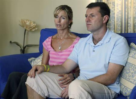 Kate and Gerry McCann, British parents of four-year-old Madeleine, are seen in Praia da Luz beach resort in the southern province of Algarve, in this August 10, 2007 file photo. REUTERS/Francisco Leong/Pool/Files