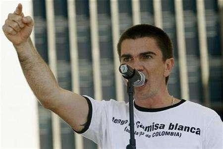 Colombian singer Juanes sings during a protest against violence and kidnapping in Medellin, Colombia, July 5, 2007. With more than 8 million albums sold worldwide, Juanes -- real name Juan Esteban Aristizabal -- still has the air of an accidental star. REUTERS/Fredy Amariles