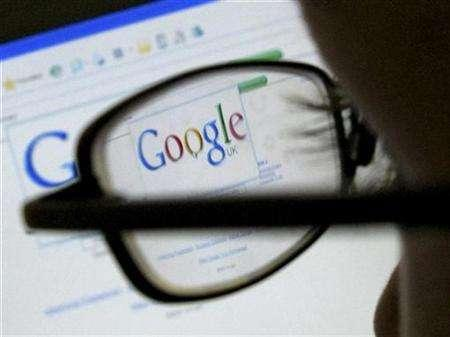 A Google search page is seen through the spectacles of a computer user in Leicester, central England July 20, 2007. Google will sponsor a $30 million competition for an unmanned lunar landing, following up on the $10 million Ansari X Prize that spurred a private sector race to space. REUTERS/Darren Staples