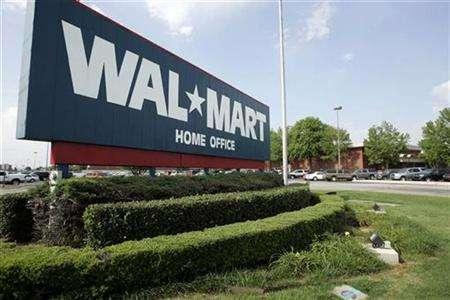 A sign marks Wal-Mart's headquarters in Bentonville, Arkansas June 1, 2007. Wal-Mart Stores Inc has formed a partnership with the Carbon Disclosure Project to look for ways for its suppliers to better manage their energy efficiency, as part of its environmental push, the company said on Monday. REUTERS/Jessica Rinaldi