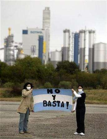 Members of the Argentine Citizen's Environmental assembly demonstrate near the Metsa-Botnia pulp mill that is being built on the Uruguayan side of the River Uruguay with a flag that reads '' No and that's It'' September 2, 2007. Metsa-Botnia, Europe's second-biggest paper pulp producer, said on Monday the startup of its new mill in Uruguay had been delayed, awaiting final environmental approval from authorities. REUTERS/Andres Stapff