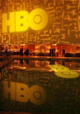 The HBO network logo is projected on a wall and reflected in the pool of the Beverly Hilton prior to an after-party to celebrate the Golden Globes in Los Angeles, California January 16, 2006. REUTERS/Lucas Jackson