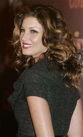 Country music singer Faith Hill arrives for the taping of the Country Music Television special ''CMT Giants'' in Hollywood, California October 26, 2006. REUTERS/Fred Prouser