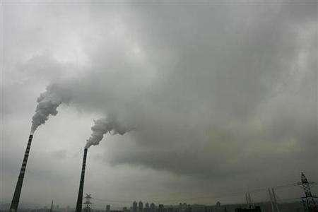 Smoke billows from chimneys at a power plant in southwest China's Chongqing municipality September 8, 2007. China is considering an environmental tax on polluters to cut emissions, a senior government official said on Monday. REUTERS/Stringe