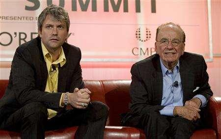 News Corp Chairman Rupert Murdoch (R) and MySpace Chief Executive Chris DeWolfe attend the Web 2.0 summit in San Francisco, California, October 17, 2007. REUTERS/Kimberly White