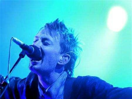 Thom Yorke, lead singer of Radiohead performs at the Glastonbury Festival in Somerset, June 28, 2003. Listeners now have many new ways to buy music online -- from subscription and set-your-own price to advertising-supported. Radiohead sold its new album as a digital download at its Web site for as much or as little as fans wanted to pay. REUTERS/Toby Melville