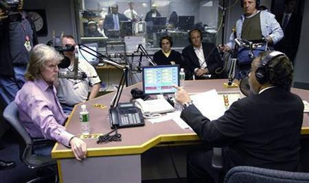Radio talk-show host Don Imus speaks with Rev Al Sharpton during Sharpton's radio show, in New York, April 9, 2007. Imus, who was fired by CBS Radio six months ago in an uproar over an on-air racial slur he made, has signed a deal to return to radio on Dec. 3 with a new nationally syndicated morning show. REUTERS/Chip East