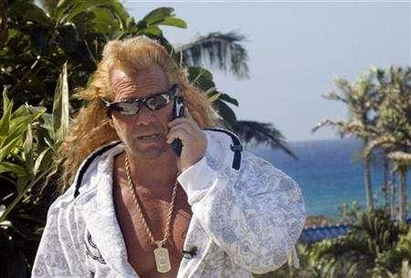 Duane ''Dog'' Chapman takes a call from his attorney updating him about about his case in Quadalajara, Mexico, at his home in Honolulu, Hawaii January 16, 2007. Chapman has prompted a cable network to stop production on his show after a private phone call in which he used a racial slur was posted on the Internet. REUTERS/Lucy Pemoni