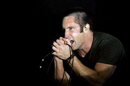 Trent Reznor of music group Nine Inch Nails performs at the Voodoo Music Experience concert held at Riverview Park in New Orleans, Louisiana October 29, 2005. Nine Inch Nails frontman Trent Reznor has spent the past few years using new methods to disseminate his music to fans. Past experiments have included hidden messages on T-shirts, ''forgotten'' USB drives in bathrooms containing copies of his last record, ''Year Zero,'' and cryptic Web sites, all culminating in a prerelease free stream on the band's MySpace page. REUTERS/Lucas Jackson